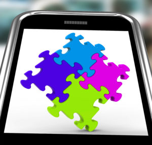 Puzzle Squares On Smartphone Shows Pieces of Online Marketing