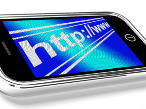 smartphone with URL address of a website redesign