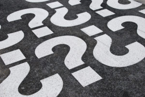 question marks painted on a asphalt road surface signifying seo questions