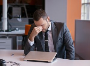 frustrated young business man irritated that content marketing isn't working