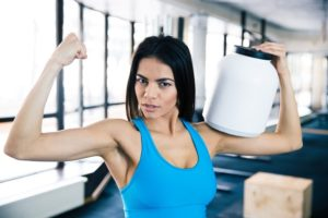 Fit woman showing her muscles ready to optimize website
