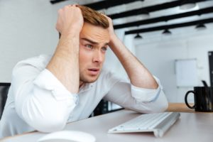 young businessman upset because of drop in website traffic